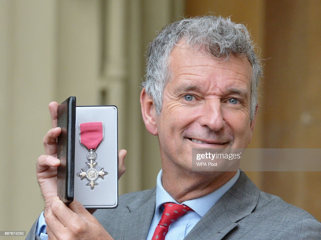Tony Hawks poses with his Member of the British Empire (MBE) medal that was presented to him by the Prince of Wales during an Investiture ceremony on December 7, 2017 at Buckingham Palace, London.