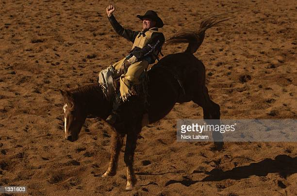 Tony Hecksher rides in the Bareback event during the Mount Isa Rodeo held in Mount Isa Australia on August 11 2002 The rodeo event held in the...