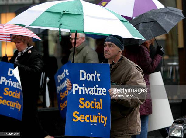 Tony Hernandez of Chelsea protested with others outside of 85 Merrimac Street regarding privatizing social security and Mitt Romney's stand on it...