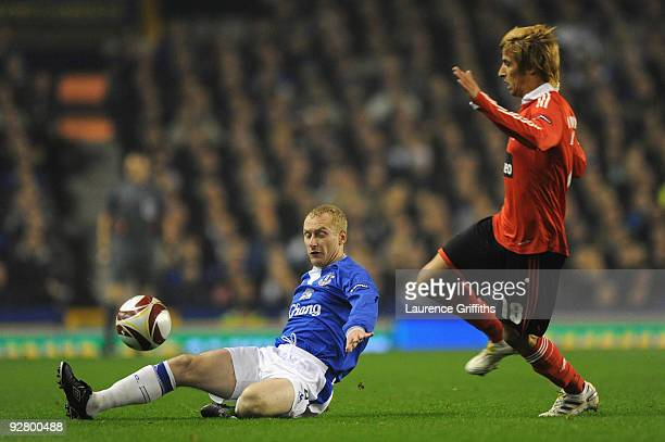 Tony Hibbert of Everton competes for the ball with Fabio Coentrao of Benfica during the UEFA Europa League Group I match between Everton and Benfica...