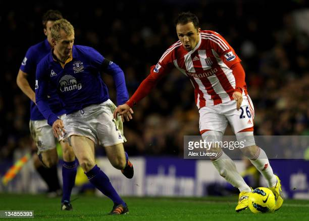Tony Hibbert of Everton competes with Matthew Etherington of Stoke City during the Barclays Premier League match between Everton and Stoke City at...
