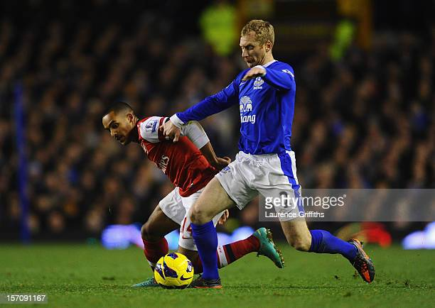 Tony Hibbert of Everton competes with Theo Walcott of Arsenal during the Barclays Premier League match between Everton and Arsenal at Goodison Park...