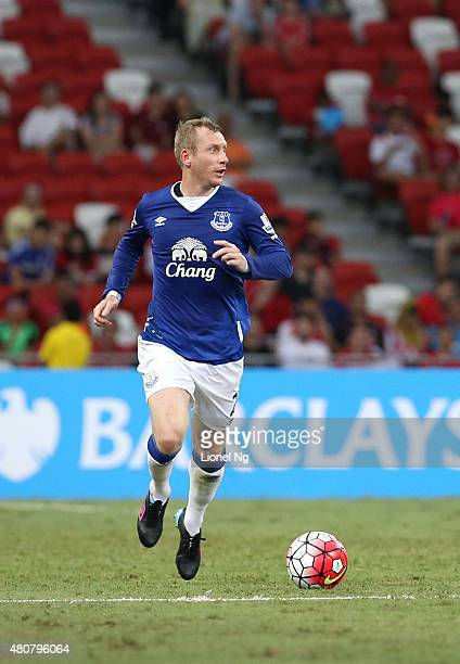 Tony Hibbert of Everton dribbles the ball during the Barclays Asia Trophy match between Everton and Stoke City at National Stadium on July 15, 2015...