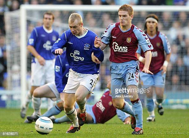 Tony Hibbert of Everton holds off a challenge from Steven Davis of Aston Villa during the Barclays Premiership match between Everton and Aston Villa...