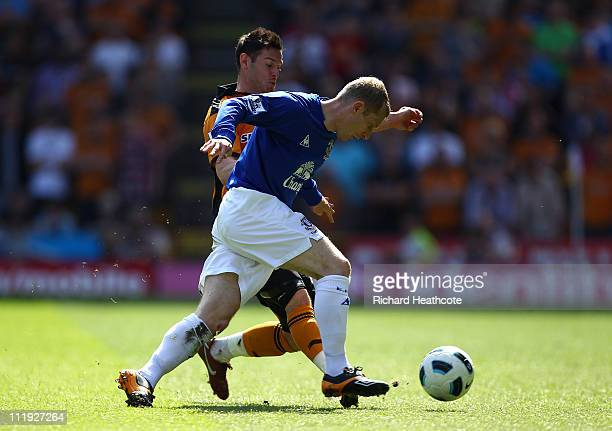 Tony Hibbert of Everton holds off Matt Jarvis of Wolves during the Barclays Premier League match between Wolverhampton Wanderers and Everton at...