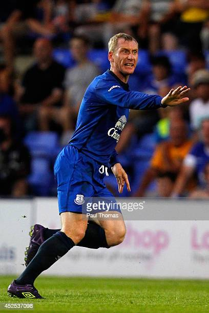 Tony Hibbert of Everton in action during the Pre Season Friendly between Tranmere Rovers and Everton at Prenton Park on July 22, 2014 in Birkenhead,...