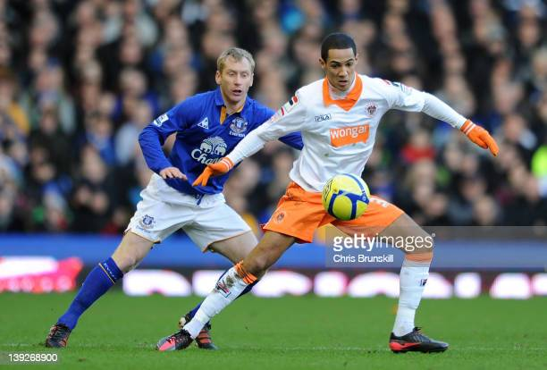 Tony Hibbert of Everton in action with Thomas Ince of Blackpool during the FA Cup Fifth Round match between Everton and Blackpool at Goodison Park on...