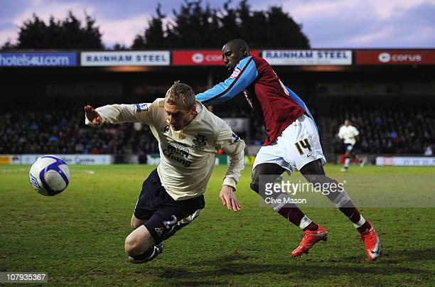 Tony Hibbert of Everton is challenged by Jonathan Forte of Scunthorpe United during the FA Cup sponsored by Eon 3rd round match between Scunthorpe...