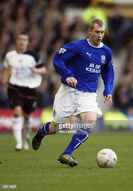 Tony Hibbert of Everton runs with the ball during the FA Cup Fourth Round match between Everton and Fulham held on January 25, 2004 at Goodison Park,...