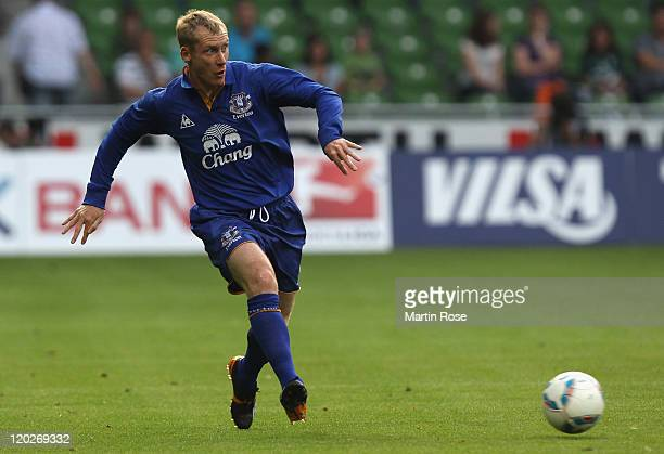 Tony Hibbert of Everton runs with the ball during the pre season friendly match between SV Werder Bremen and Everton at Weser Stadium on August 2,...