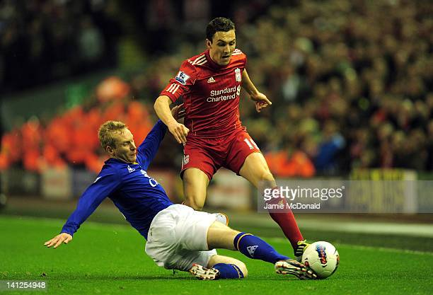Tony Hibbert of Everton tackles Stewart Downing of Liverpool during the Barclays Premier League match between Liverpool and Everton at Anfield on...