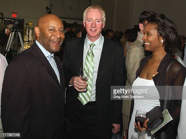 """Tony Hobson of Self Enhancement Incorporated, left, with guests at """"Catwalk"""", a fashion event to support the """"Boost Foundation"""", featuring the..."""
