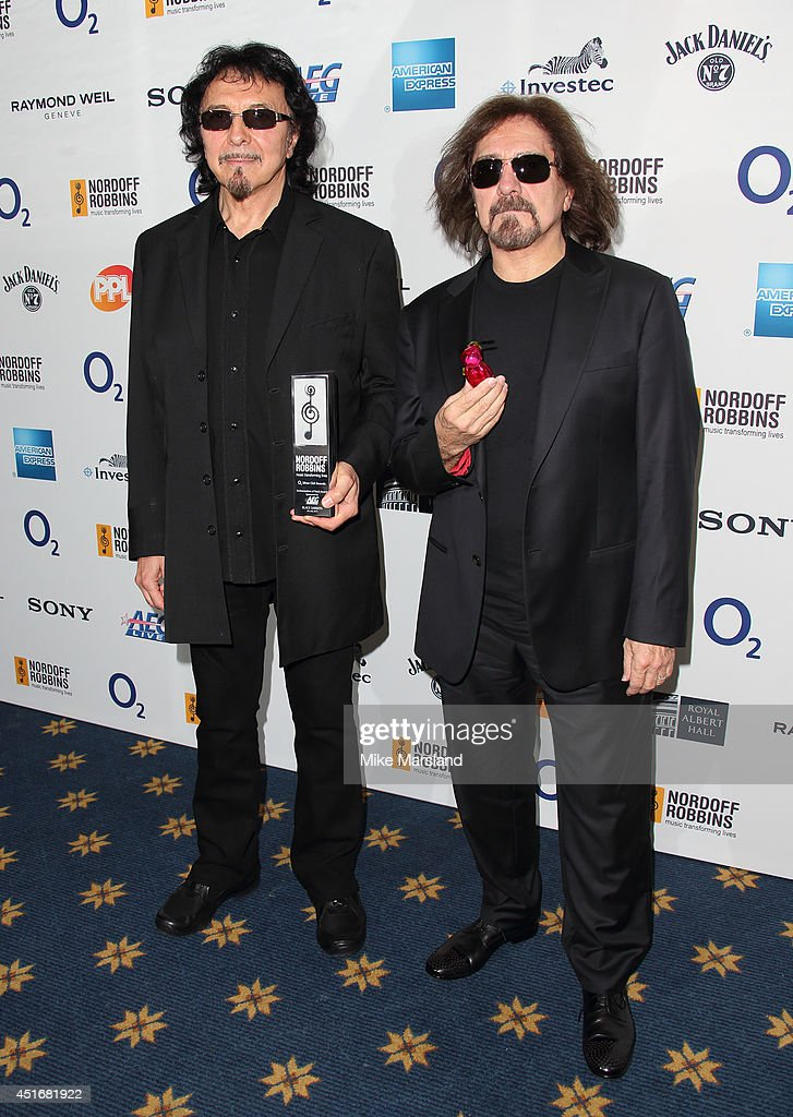 Tony Iommi and Geezer Butler attend the Nordoff Robbins 02 Silver Clef awards at London Hilton on July 4, 2014 in London, England.