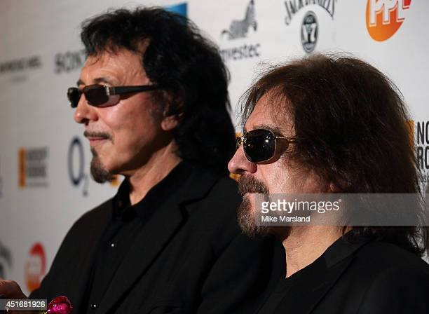 Tony Iommi and Geezer Butler attend the Nordoff Robbins 02 Silver Clef awards at London Hilton on July 4 2014 in London England