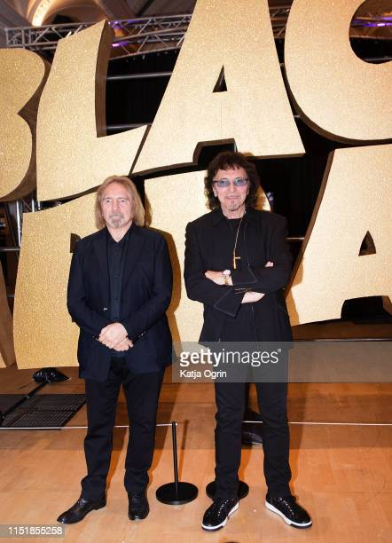Tony Iommi and Geezer Butler of Black Sabbath attend a photocall ahead of the opening of Home Of Metal Black Sabbath 50 Years Anniversary exhibition...