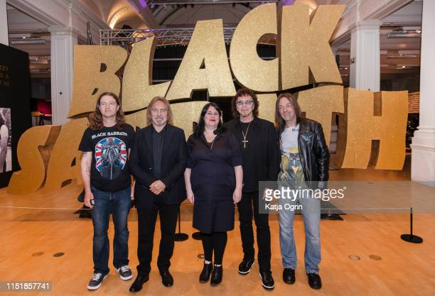 Tony Iommi and Geezer Butler of Black Sabbath pose with Lisa Meyer and two band's superfans Stephen Knowle and Chris Hopkins during a photocall ahead...