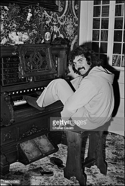 Tony Iommi Black Sabbath's guitarist poses with an antique organ at his Manor House home in Staffordshire 1975