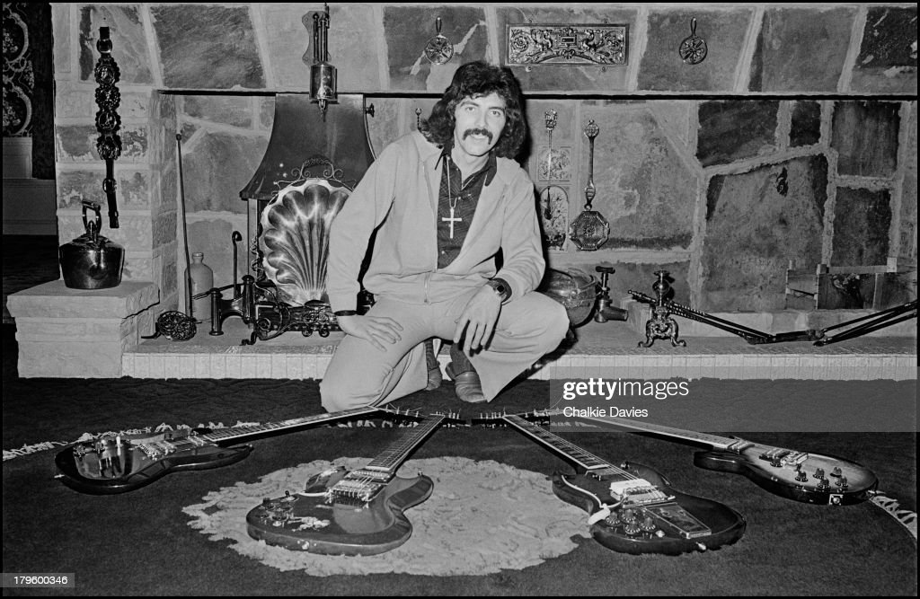 Tony Iommi, guitarist with Black Sabbath, poses with a selection of his guitars at his manor house home in Staffordshire, UK, 1975.