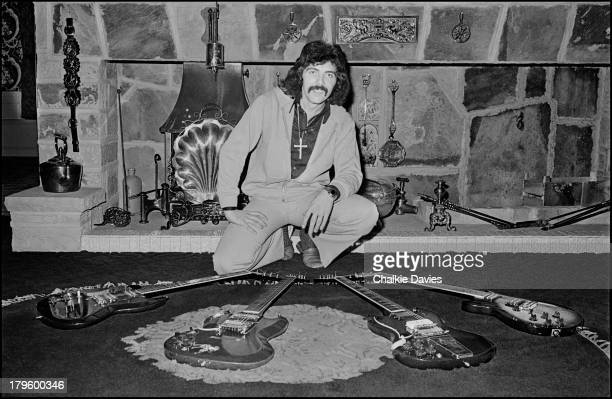 Tony Iommi guitarist with Black Sabbath poses with a selection of his guitars at his manor house home in Staffordshire UK 1975