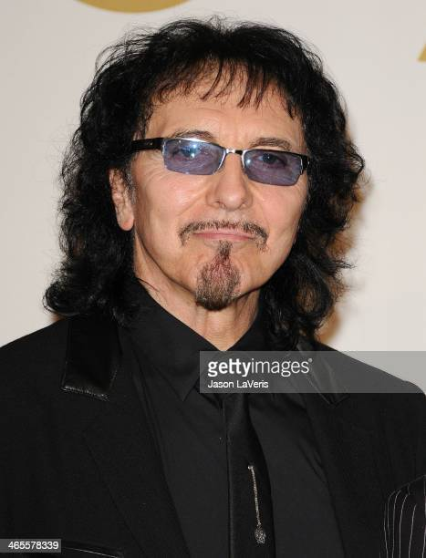 Tony Iommi of Black Sabbath poses in the press room at the 56th GRAMMY Awards at Staples Center on January 26 2014 in Los Angeles California