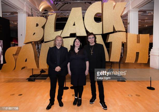Tony Iommmi and Geezer Butler of Black Sabbath pose with Lisa Meyer who is in charge of Home of Metal project during a photocall ahead of the opening...