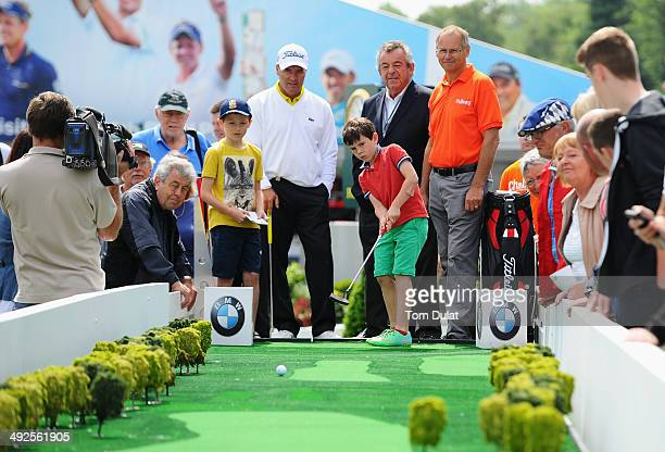 Tony Jacklin, David Clinton, Chairman of the Challengers charity and Thomas Levet of France watch children putt during the launch of the Mega Putt...