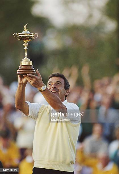 Tony Jacklin of England and European team Captain holds the trophy after winning the 28th Ryder Cup Matches on 24th September 1989 at The Belfry in...