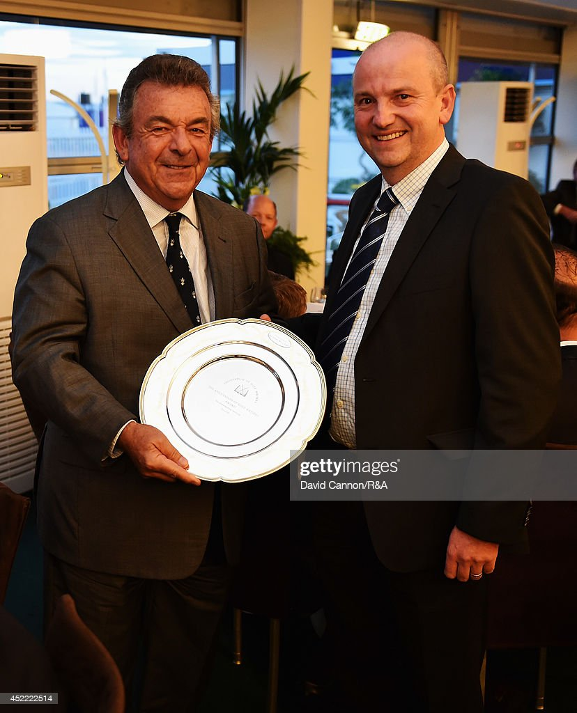 Tony Jacklin (L) of England is presented with the Michael Williams Association of Golf Writers award for Outstanding Service to Golf by Roddy Williams (R) during the AGW annual dinner prior to the start of the 143rd Open Championship at Royal Liverpool on July 15, 2014 in Hoylake, England.