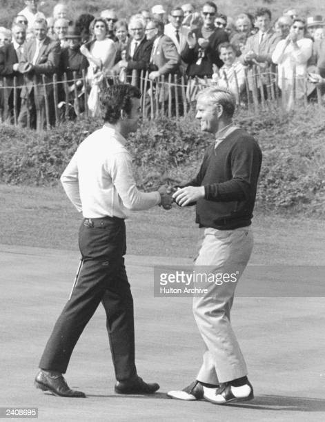 Tony Jacklin of Great Britain and Jack Nicklaus of the USA congratulate eachother after jointly winning the Ryder Cup singles competition at...