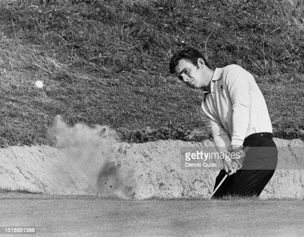 Tony Jacklin of Great Britain chips out of the bunker on to the 5th green in the morning foursomes during the 18th Ryder Cup Matches on 19th...