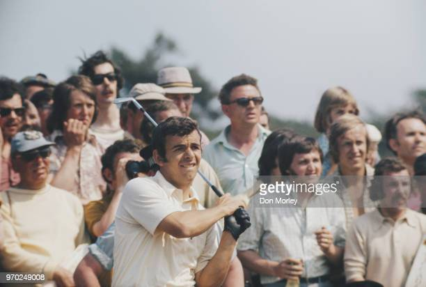 Tony Jacklin of Great Britain follows his ball onto the green during the 101st Open golf championship on12 July 1972 at The Muirfield Golf Club in...