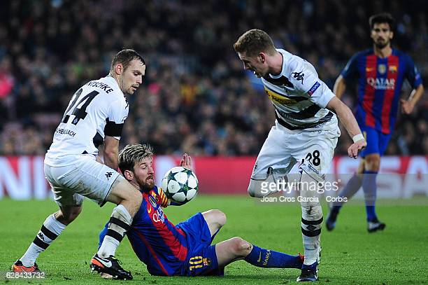 Tony Jantschke and André Hahn of Borussia Mönchengladbach and Lionel Messi of FC Barcelona fighting for the ball during the UEFA Champions League...