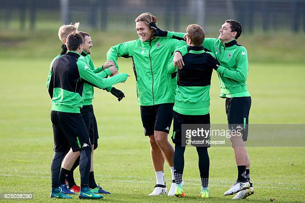 Tony Jantschke and Jannik Vestergaard attend a taining session ahead of the UEFA Champions League match between Borussia Moenchengladbach and...
