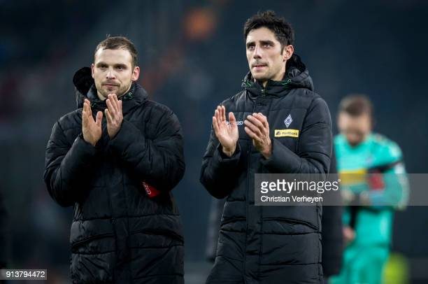 Tony Jantschke and Lars Stindl of Borussia Moenchengladbach look disappointed after the Bundesliga match between Borussia Moenchengladbach and RB...
