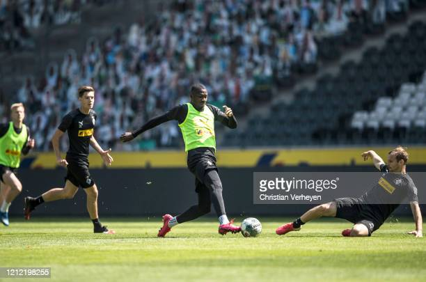Tony Jantschke and Marcus Thuram in action during a training session of Borussia Moenchengladbach at BorussiaPark on May 08 2020 in Moenchengladbach...