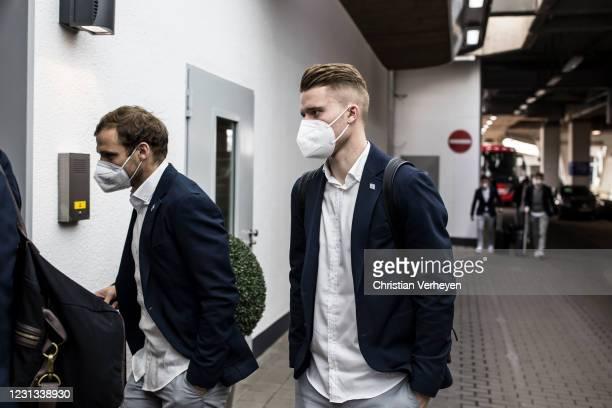 Tony Jantschke and Nico Elvedi of Borussia Moenchengladbach are seen as the team travel to Budapest for their upcoming UEFA Champions League match,...