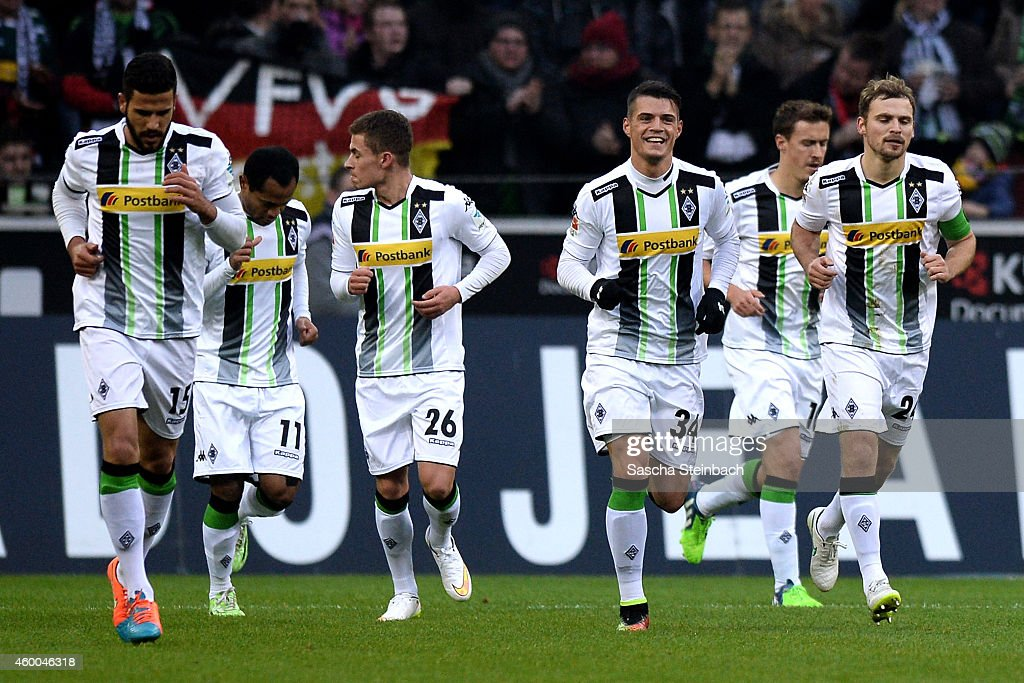Tony Jantschke (R) celebrates with team mates after scoring the opening goal during the Bundesliga match between Borussia Moenchengladbach and Hertha BSC Berlin at Borussia Park Stadium on December 6, 2014 in Moenchengladbach, Germany.