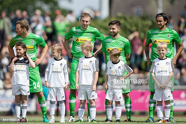 Tony Jantschke Christoph Kramer Julian Korb and Andreas Christensen of Borussia Moenchengladbach stand on the pitch prior the friendly match between...