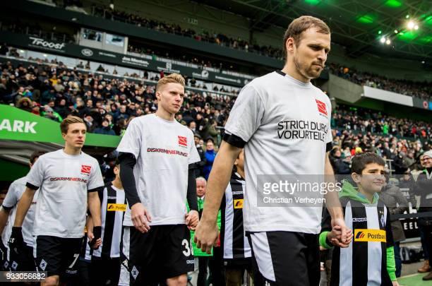 Tony Jantschke Nico Elvedi and Patrick Herrmann of Borussia Moenchengladbach enter the pitch with mascot kids prior to the Bundesliga match between...