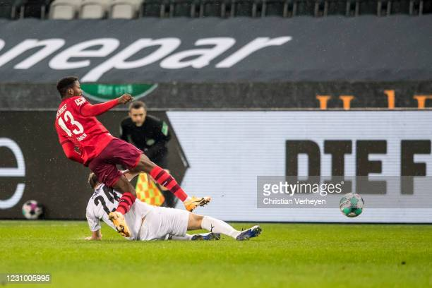 Tony Jantschke of Borussia Moenchengladbach and Emmanuel Dennis of 1. FC Koeln battle for the ball during the Bundesliga match between Borussia...