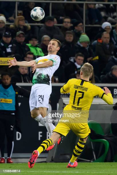 Tony Jantschke of Borussia Moenchengladbach and Erling Haaland of Borussia Dortmund battle for the ball during the Bundesliga match between Borussia...