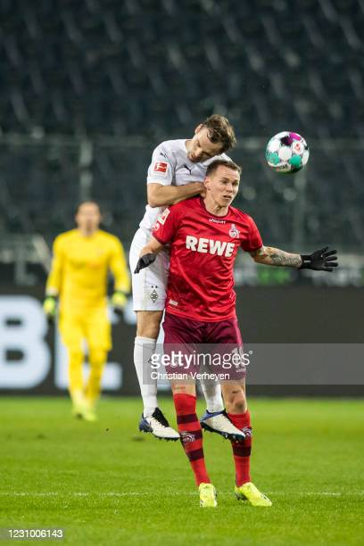 Tony Jantschke of Borussia Moenchengladbach and Ondrej Duda of 1. FC Koeln battle for the ball during the Bundesliga match between Borussia...