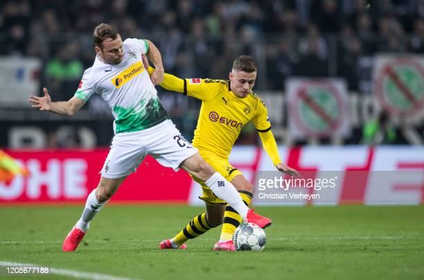 Tony Jantschke of Borussia Moenchengladbach and Thorgan Hazard of Borussia Dortmund battle for the ball during the Bundesliga match between Borussia...
