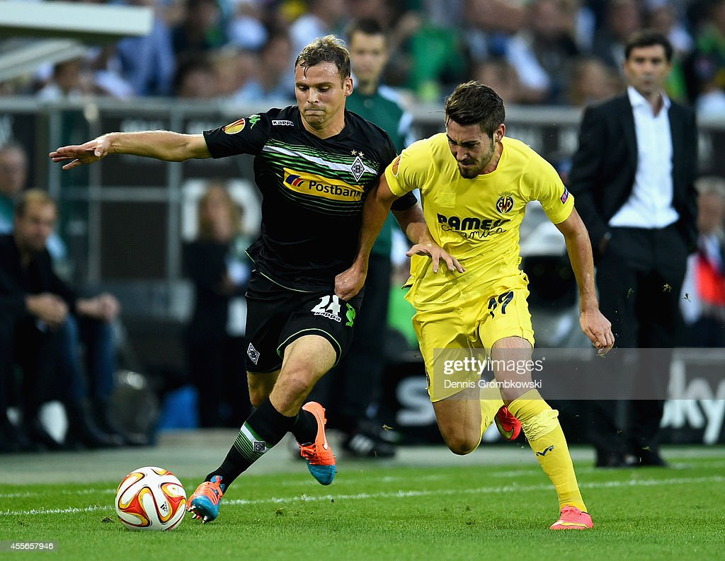 Tony Jantschke of Borussia Moenchengladbach is challenged by Moi Gomez of Villareal CF during the UEFA Europa League Group A match between Borussia Moenchengladbach and Villareal CF at Borussia-Park Stadium on September 18, 2014 in Moenchengladbach, Germany.