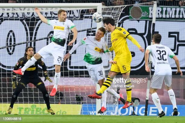 Tony Jantschke of Borussia Moenchengladbach Nico Elvedi of Borussia Moenchengladbach Mats Hummels of Borussia Dortmund and Florian Neuhaus of...