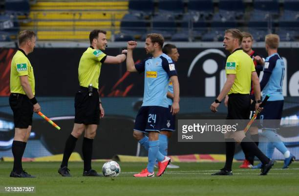 Tony Jantschke of Borussia Moenchengladbach taps elbows with referees after the Bundesliga match between Eintracht Frankfurt and Borussia...
