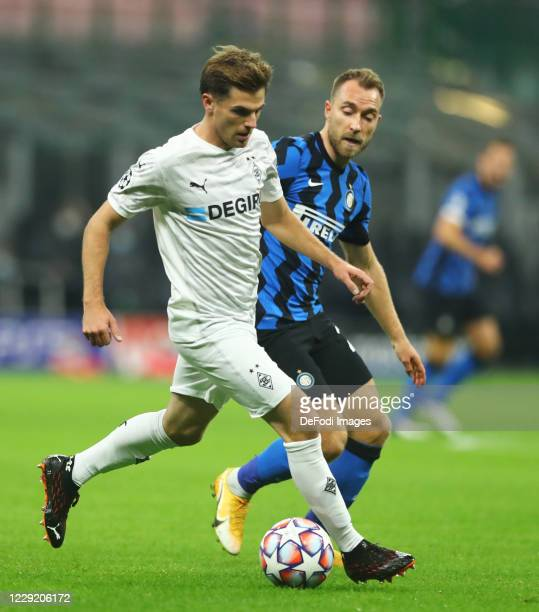 Tony Jantschke of Borussia Monchengladbach and Christian Eriksen of FC Internazionale battle for the ball during the UEFA Champions League Group B...