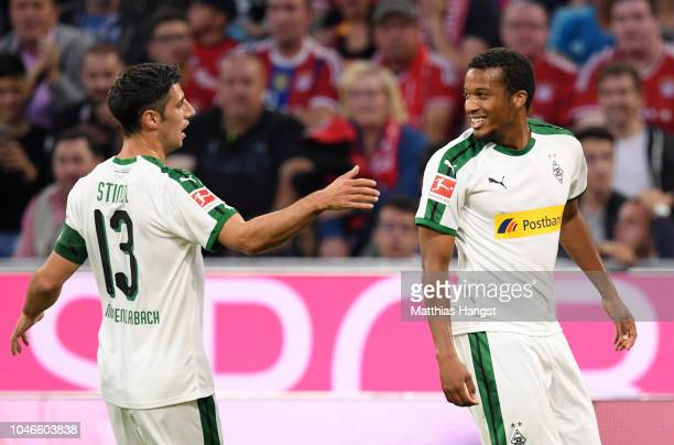 Tony Jantschke of Borussia Monchengladbach celebrates with teammate Lars Stindl of Borussia Monchengladbach after scoring his team's first goal...