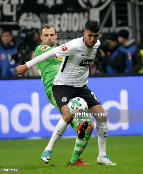 Tony Jantschke of Moenchengladbach and Aymen Barkok of Frankfurt battle for the ball during the Bundesliga match between Eintracht Frankfurt and...