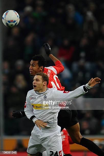 Tony Jantschke of Moenchengladbach and Eric Maxim Choupo-Moting of Mainz jump for a header during the Bundesliga match between Borussia...